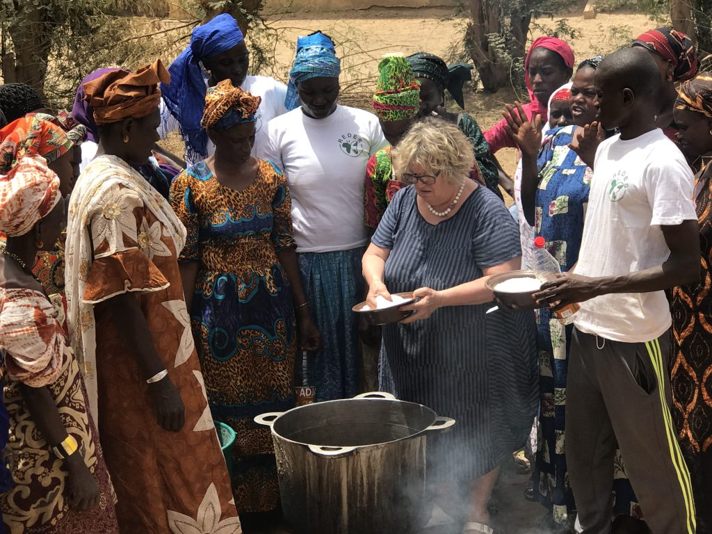 Pellicano cooking with people form the community of Guédé Chantier, Senegal